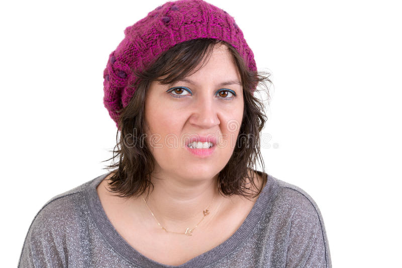Nasty vindictive woman with a cold mean stare. Looking at the camera with a sneer, head and shoulders isolated on white royalty free stock image