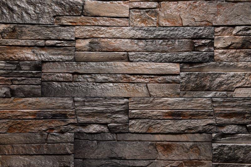 Natürliche Farbe des braunen Wandbeschaffenheits-Steinhintergrundes lizenzfreie stockfotografie