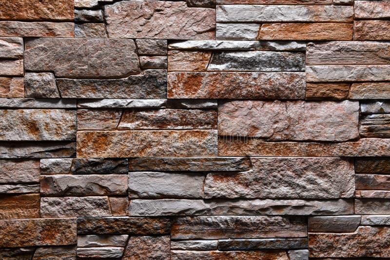 Natürliche Farbe des grauen braunen orange Wandbeschaffenheits-Steinhintergrundes stockfotografie