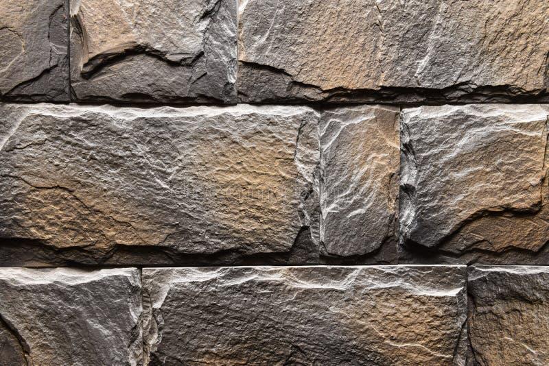 Natürliche Farbe des grauen orange Steinwand-Beschaffenheitshintergrundes stockbild