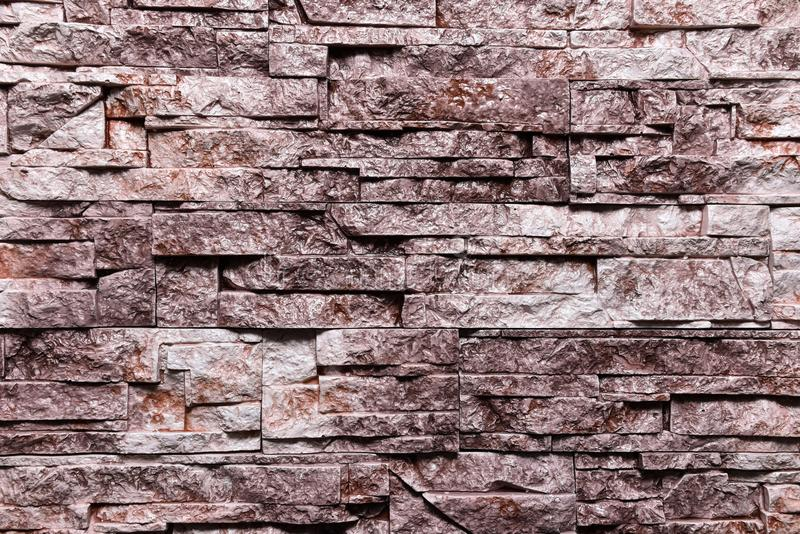 Natürliche Farbe des rotbraunen Steinwand-Beschaffenheitshintergrundes stockbilder