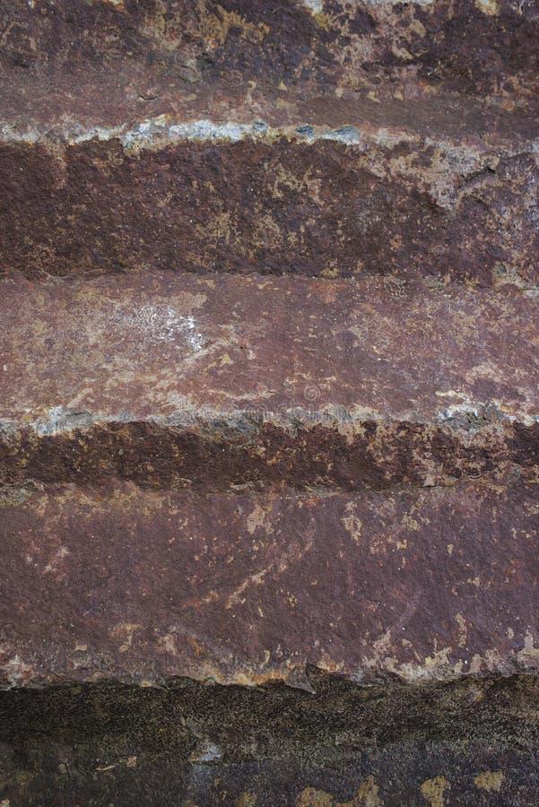 Natürliche Felsenbeschaffenheit der Nahaufnahme, ockerhaltig-rote Töne lizenzfreies stockfoto