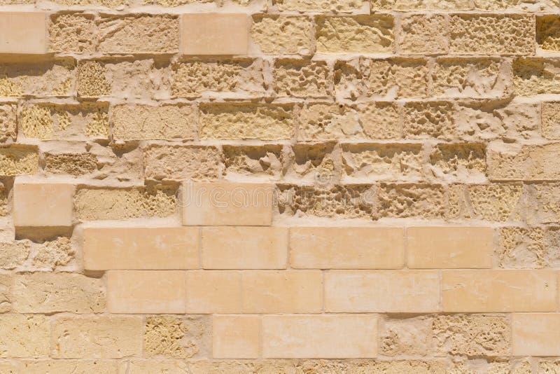 Natürliche Kalkstein-Wand in Malta stockbilder