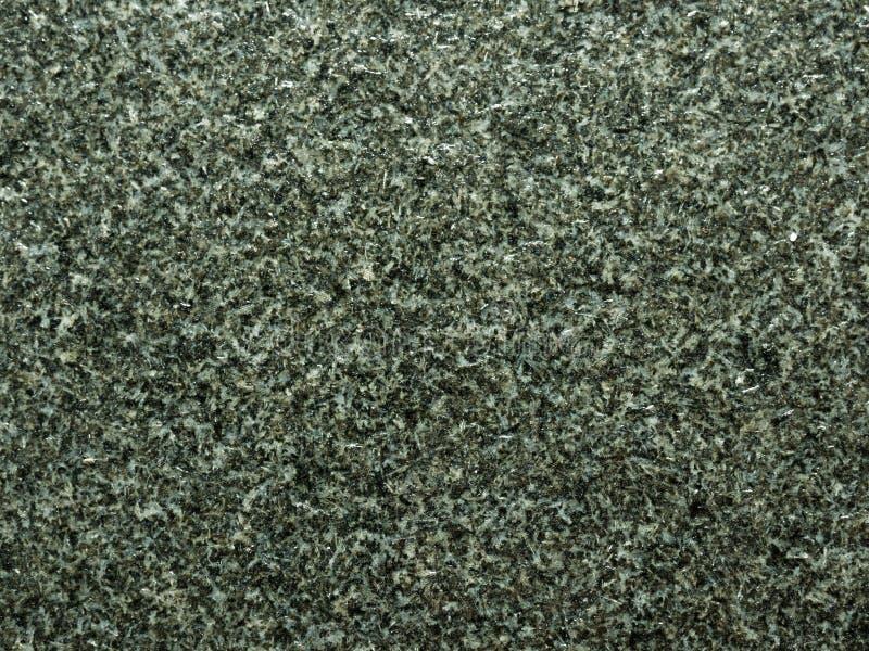 Natürliche organische Beschaffenheit der schwarzen oder dunklen Granitzusammenfassung mit der rauen Oberfläche benutzt als Hinter stockfoto