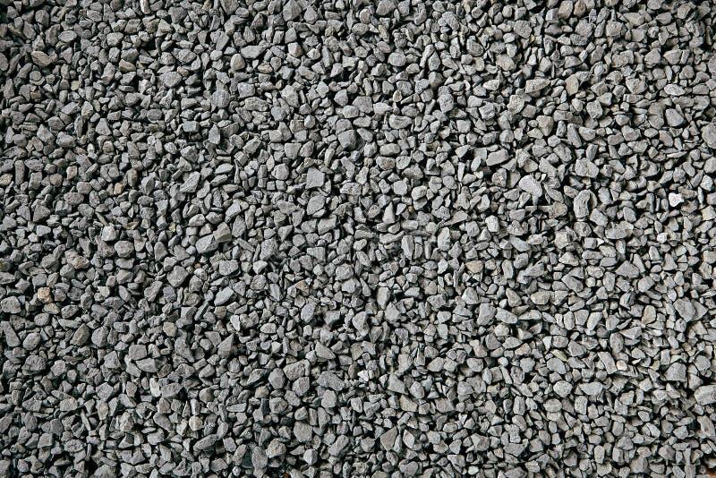 Natürlicher Gray Granite Chippings, Steinschotter, Schutt oder zerquetschte Stein-Hintergrund-Draufsicht stockbilder