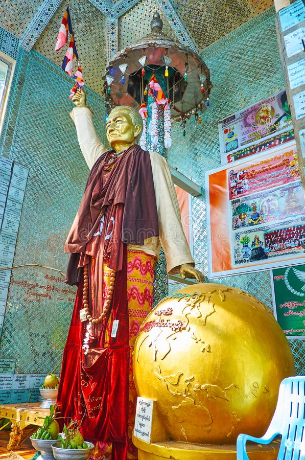 The Nat Shrine, Popa, Myanmar. POPA, MYANMAR - FEBRUARY 26, 2018: The Nat Shrine with a statue of Spirit Deity at the golden globe, the site situated on the royalty free stock photos