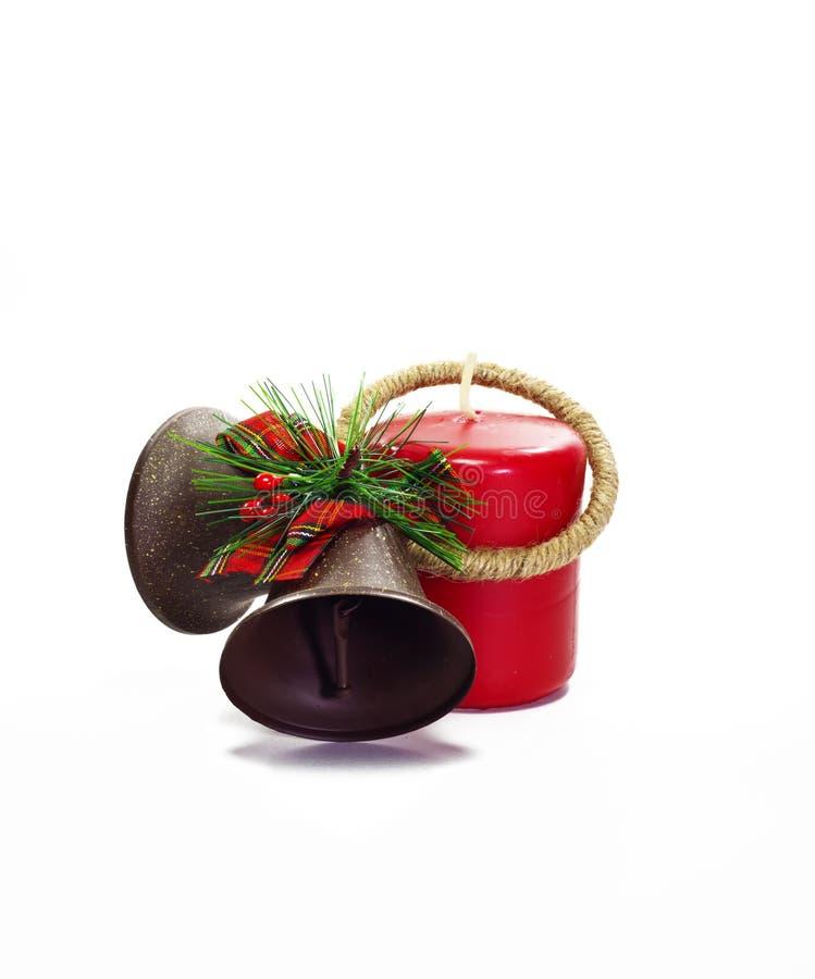 Natal Bels e vela vermelha imagens de stock