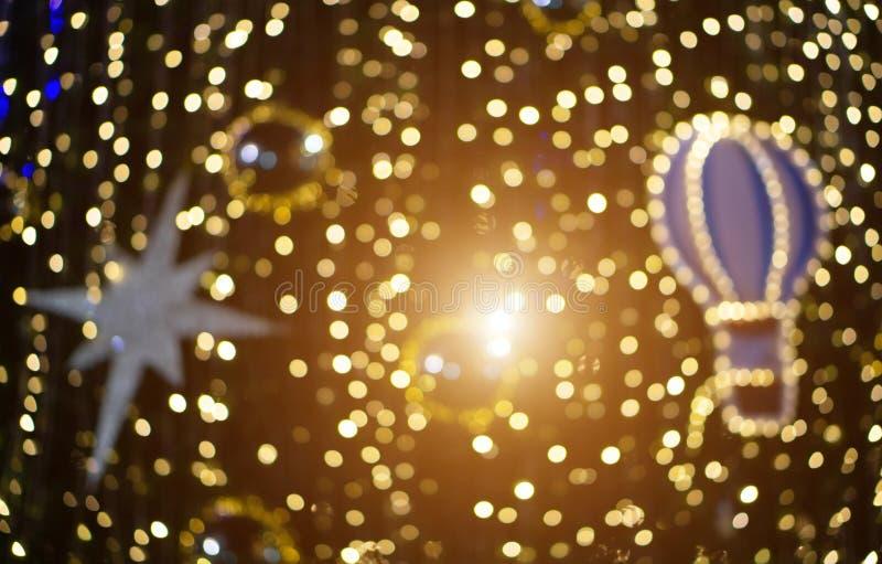 Natal borrado do brilho de Bokeh, feriado do Xmas fotos de stock royalty free