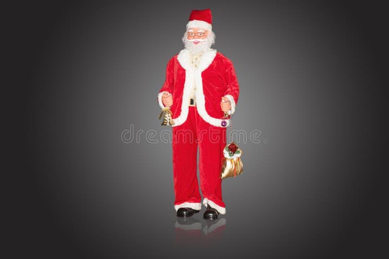 Natal Santa Claus do vintage com sinos e presentes foto de stock