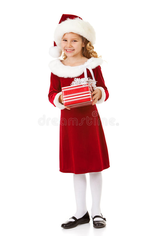 Natal: Santa Girl Holds Christmas Gift foto de stock royalty free