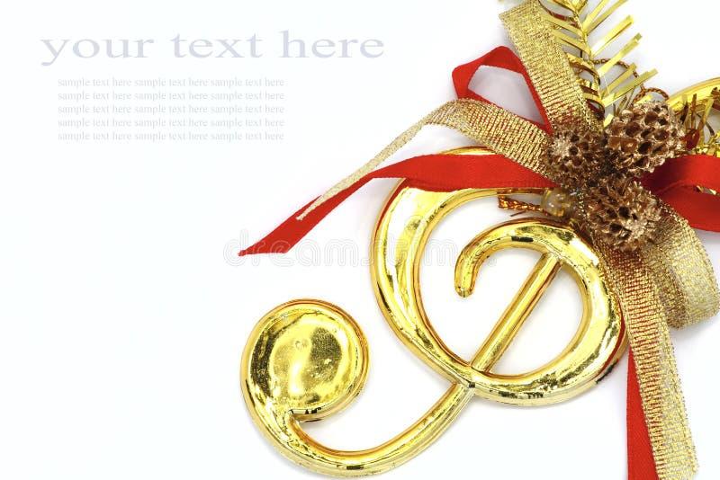 Natale con i segni ed il nastro musicali di colore. fotografia stock libera da diritti