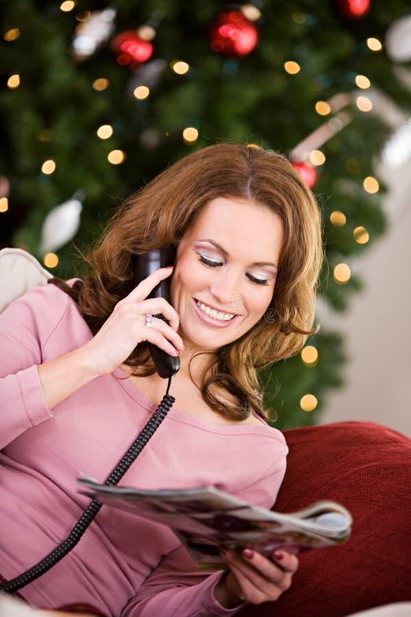Natale: Fare spesa del catalogo di festa immagine stock libera da diritti