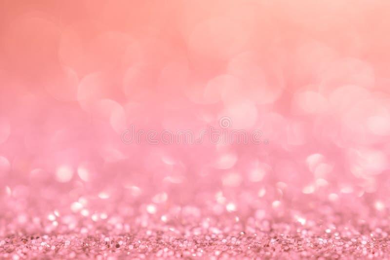 Natale rosa dell'estratto di scintillio della luce di natale del fondo con bokeh fotografia stock libera da diritti