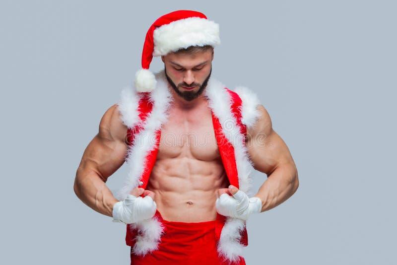 Natale Santa Claus sexy Giovane uomo muscolare che indossa Santa C immagini stock libere da diritti