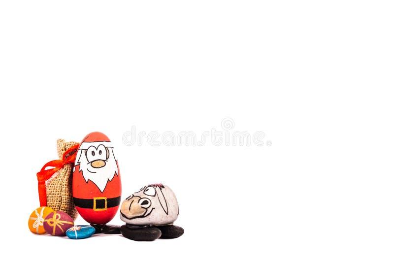 Natale Santa e la sua renna su fondo bianco immagine stock libera da diritti