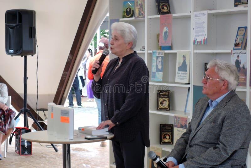 Natalia Dmitrievna Solzhenitsyna presents a book at the bokfair. Natalia Dmitrievna Solzhenitsyna presents a book at the book fair. Title of the book fair: The stock image