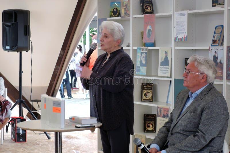 Natalia Dmitrievna Solzhenitsyna presents a book at the bokfair. Natalia Dmitrievna Solzhenitsyna presents a book at the book fair. Title of the book fair: The royalty free stock images