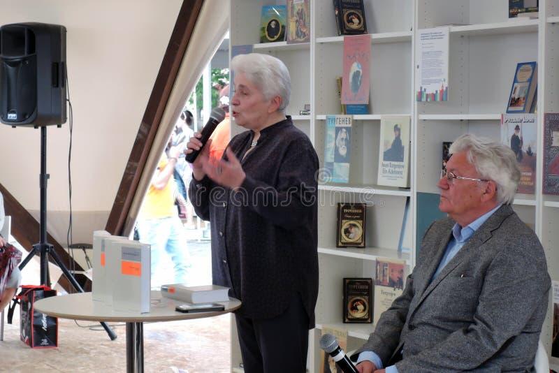 Natalia Dmitrievna Solzhenitsyna presents a book at the bokfair. Natalia Dmitrievna Solzhenitsyna presents a book at the book fair. Title of the book fair: The royalty free stock photos
