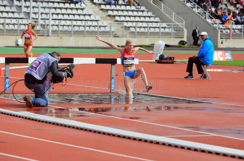 Natalya Aristarkhova from Russia COMPETE on the 3000 meters steeple on DecaNation International Outdoor Games. On September 13, 2015 in Paris, France stock photo