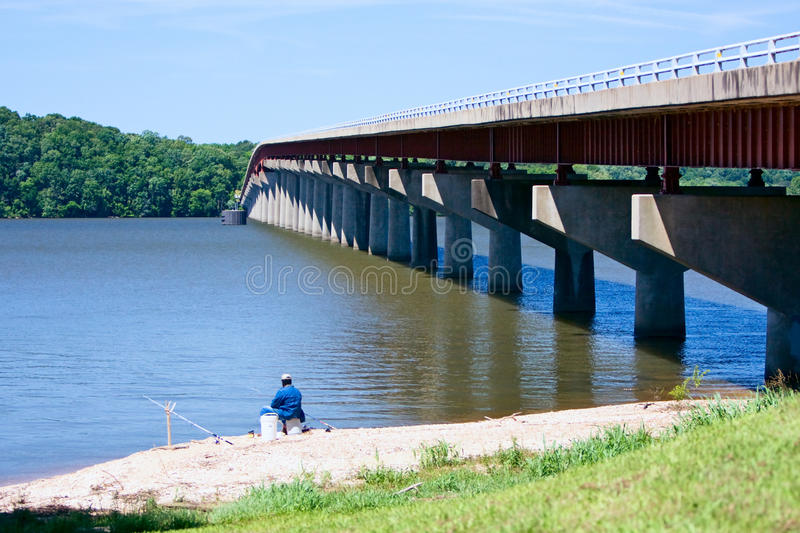 The Natchez Trace Parkway. Bridge over the Mississippi for the Natchez Trace Parkway with an angler on the foreground stock photos