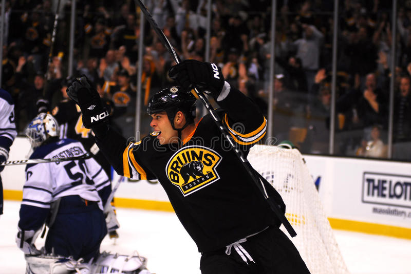 Nathan Horton Boston Bruins. Newly acquired Nathan Horton (black jersey) reacts to the Boston Bruins scoring a powerplay goal during the 1st period of a game royalty free stock images