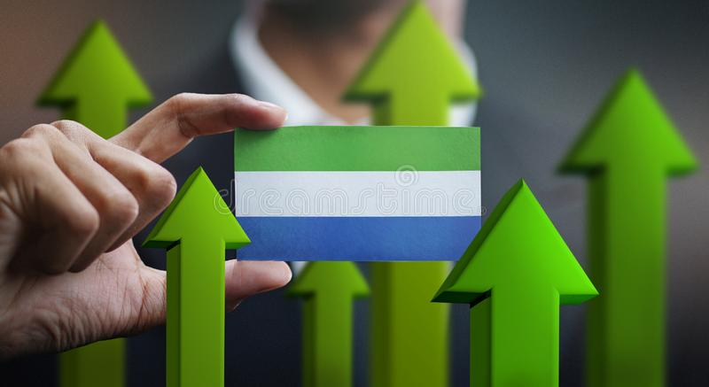 Nation Growth Concept, Green Up Arrows - Businessman Holding Car royalty free illustration