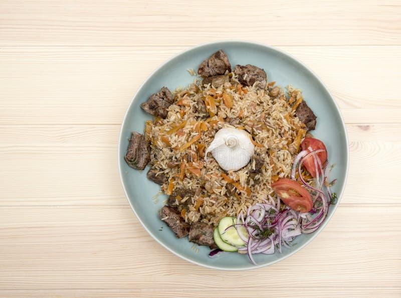 Nationaal Oezbekistaans pilau met vlees stock afbeelding