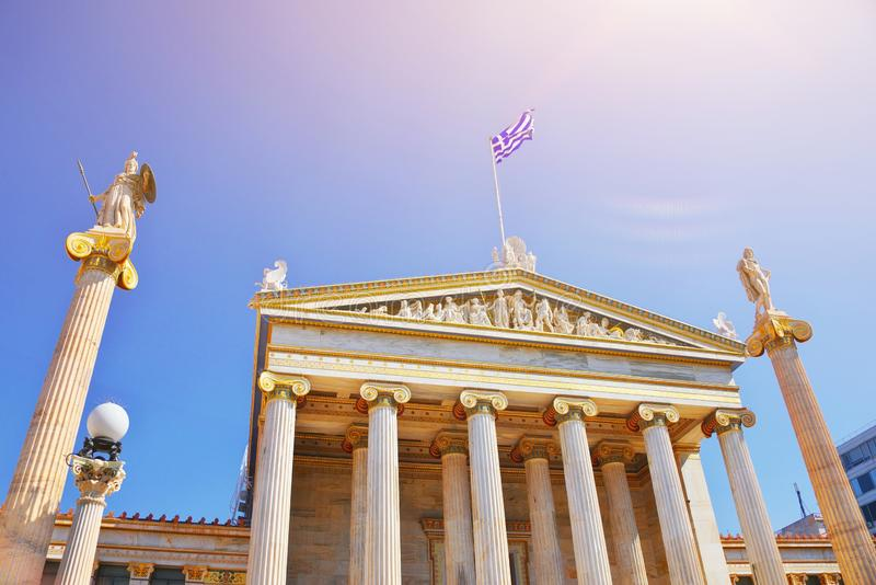National Academy of ancient Athens neoclassical building with Athena and Apollo statues. Iconic neoclassic Greek Academy of Athens stock image