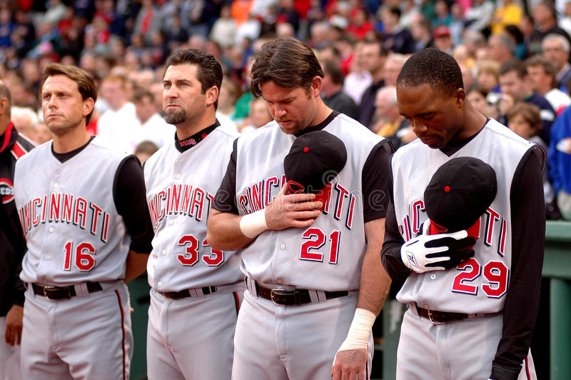 National Anthem. Sean Casey (21) and members of the Cincinnati Reds reflect during the National Anthem stock photography