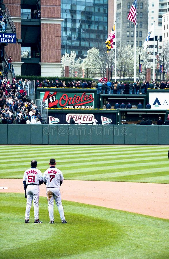 National Anthem in Baltimore. Coach Tommy Harper and Red Sox OF Trot Nixon observe the National Anthem . Image from color negative royalty free stock photo