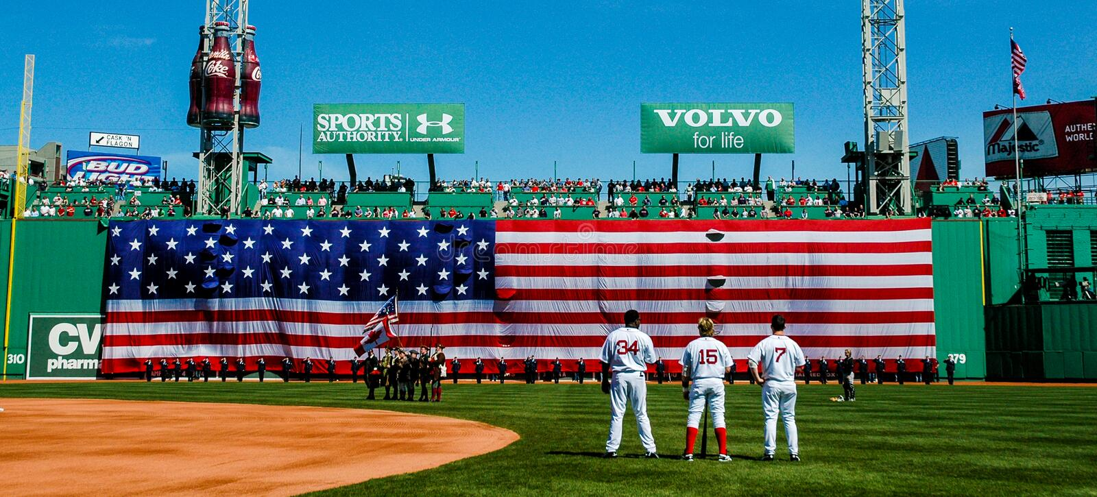 The National Anthem at Fenway Park. Red Sox David Ortiz (34), Kevin Millar (15) and Trot Nixon (7) observe the National Anthem at Fenway Park, Boston, MA royalty free stock photography
