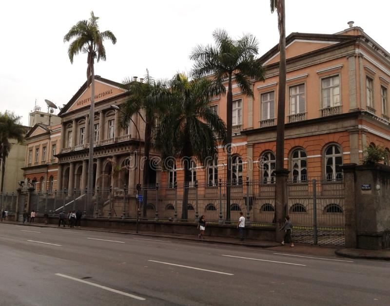 National Archive in Rio de Janeiro Downtown Brazil. Historic buildings, avenue, people, palm trees, cloudy sky, landscape stock images