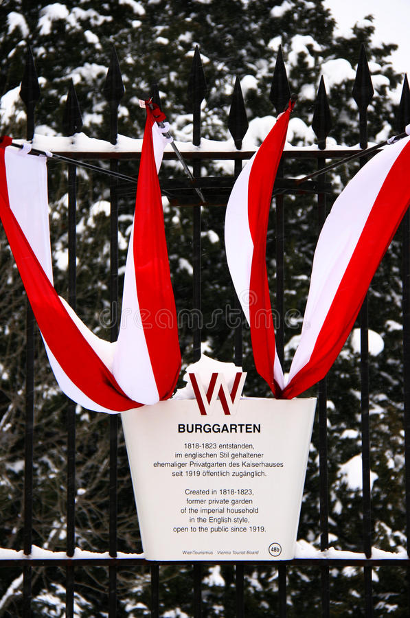 The national Austrian flag decorates imperial gardens stock image