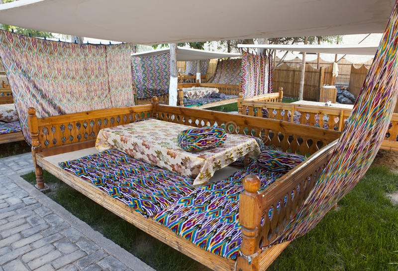 National beds for the traditional local cuisine eating. Uzbekistan royalty free stock photography