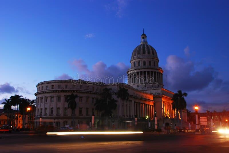 National Capital Building in Havana Cuba at Dusk. National Capital Building also known as El Capitolio in Havana Cuba at Dusk with moving traffic royalty free stock photos