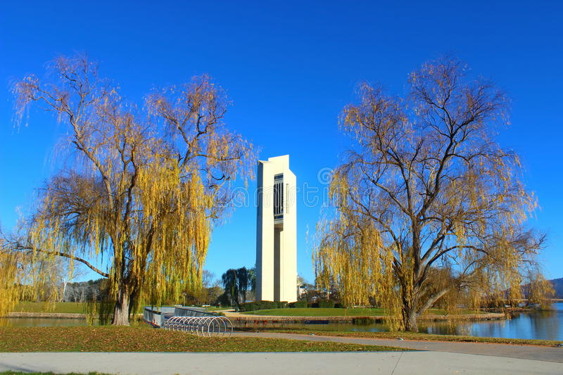 National Carillon monument on Aspen island in Canberra. National Carillon monument on Aspen island with two willows in Canberra, Australia royalty free stock image