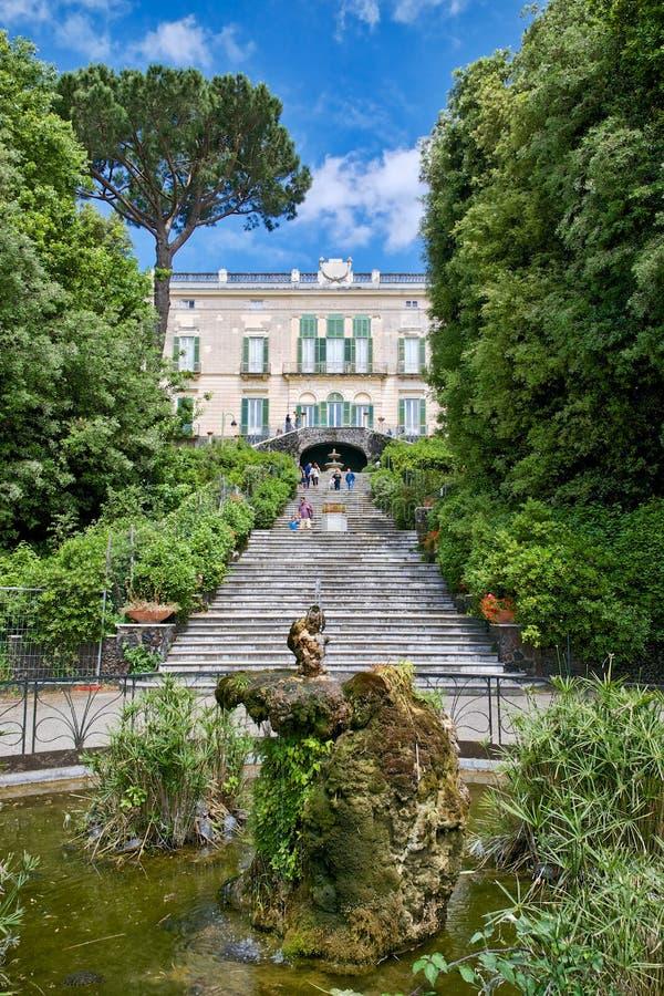 Neoclassic villa garden with fountain royalty free stock photo