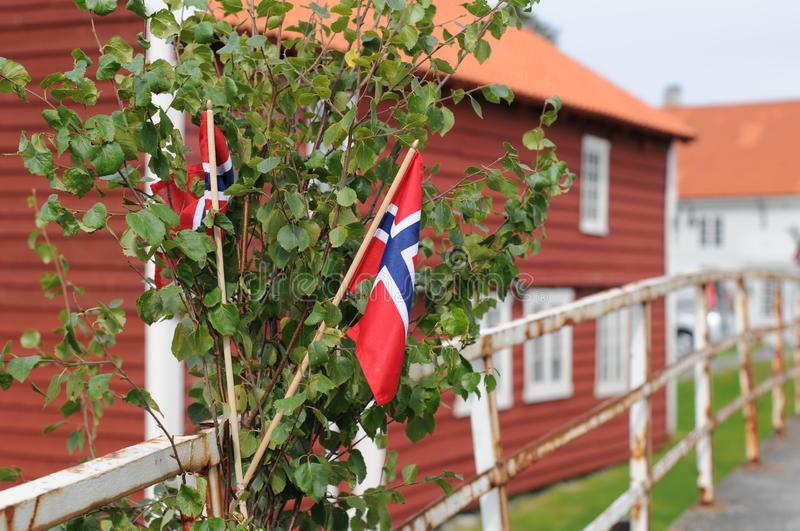 National day in Norway 17th of May with flags and birch decoration on the fence royalty free stock image