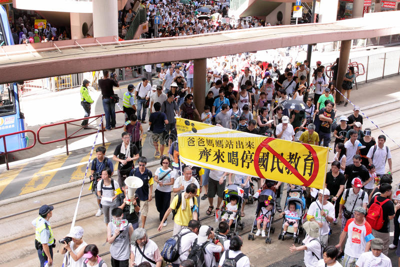 'National Education' Raises Furor in Hong Kong. Parents, children and baby against the introducing a Moral and National Education subject royalty free stock photography