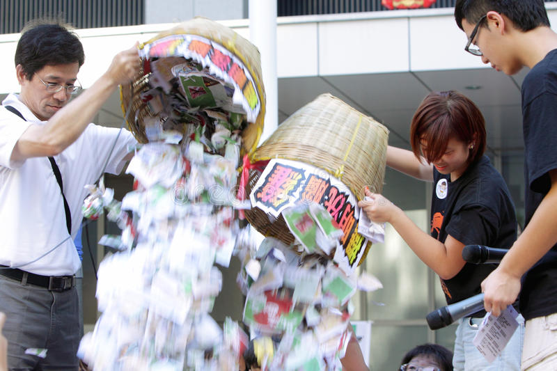 'National Education' Raises Furor in Hong Kong. Protesters tearing the booklet for National Education subject royalty free stock images
