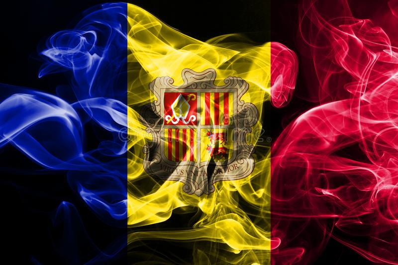 National flag of Andorra made from colored smoke isolated on black background.  royalty free illustration