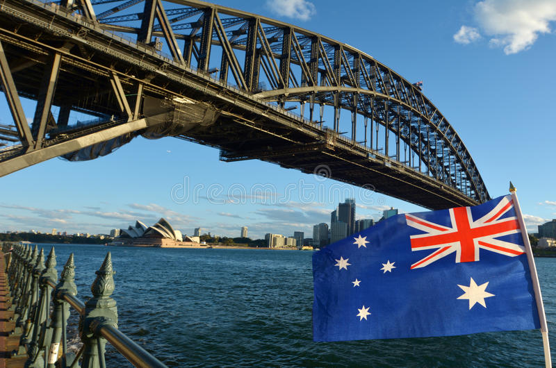 The National flag of Australia flay under Sydney Harbour Bridge stock image