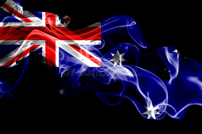 National flag of Australia made from colored smoke on black background. Abstract silky wave background royalty free stock photography