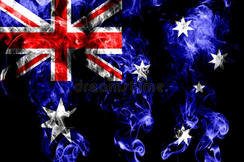 National flag of Australia made from colored smoke isolated on black background royalty free stock image