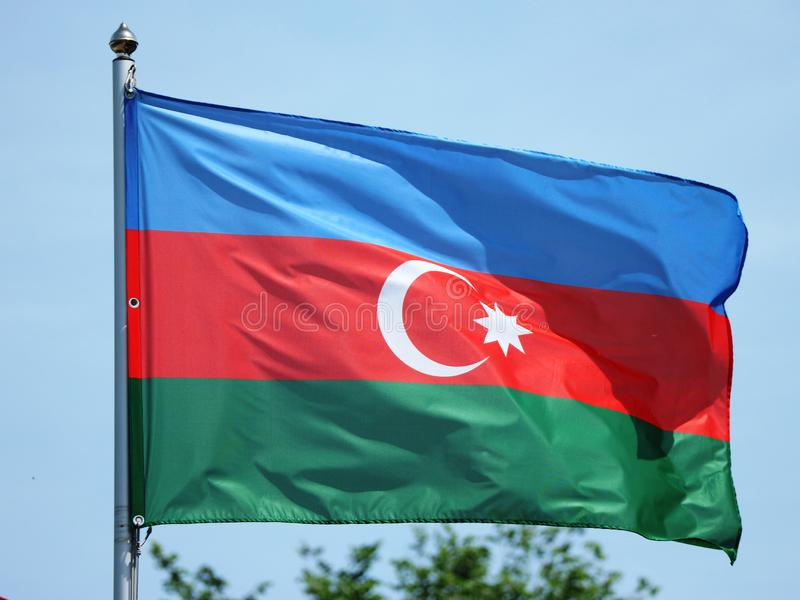 National flag of Azerbaijan waving on the wind stock images