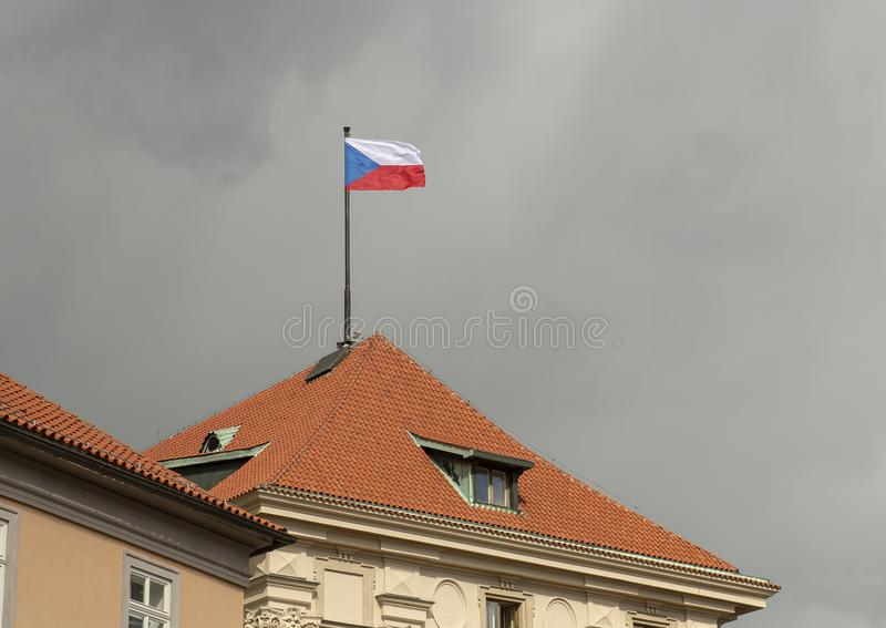 The national flag of the Czech Republic flying on a windy day against dark grey clouds. Pictured is the national flag of the Czech Republic flying in the wind royalty free stock images