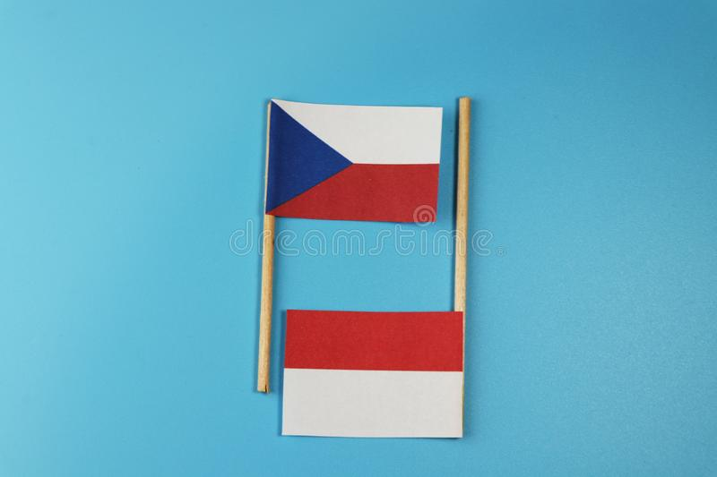 A national flag of Czech republic with national flag of Poland on wooden sticks stock photo