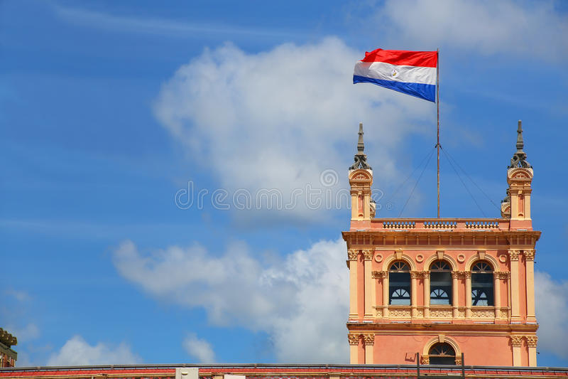 National flag flying above Presidential Palace in Asuncion, Para. Guay. It serves as a workplace for the President and the government of Paraguay stock photos