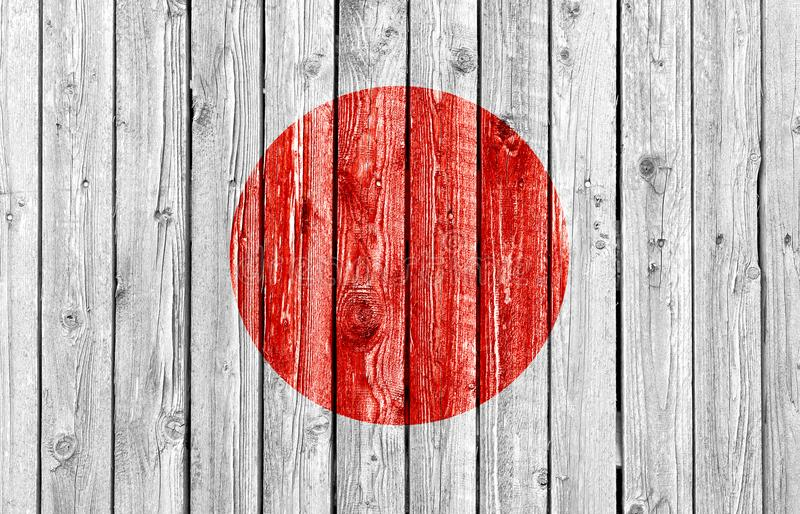 National flag of Japan on old wood background royalty free stock images
