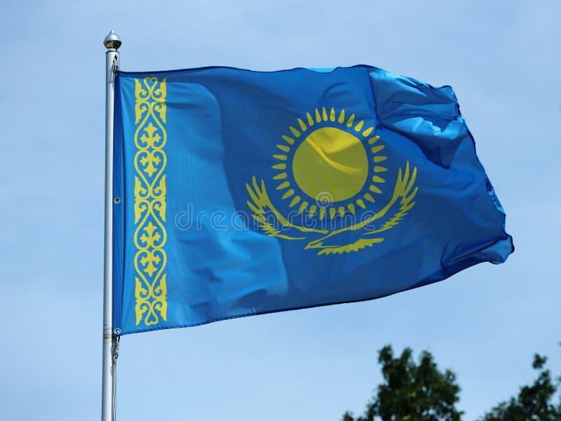 National flag of Kazakhstan waving on the wind stock image